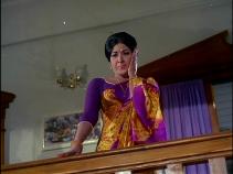 Latha sees Vijay threaten the villagers